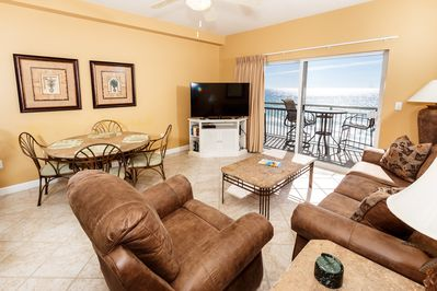 "6th floor beach front living room - Updated condo! This 6th floor beach front living room has a sleeper sofa, recliner and a new 46"" flat screen TV with TV stand. The view is Beautiful!"
