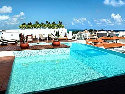 Photo for Comfortable, Fun, Beautiful roof top pool with Great Ocean View
