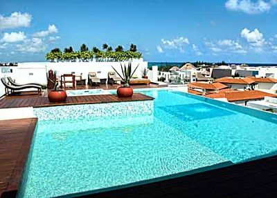 beautiful roof top pool with shallow seating area, and hot tub