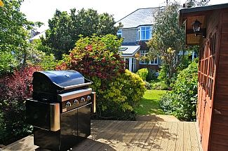 Rear Garden With BBQ And Summer House