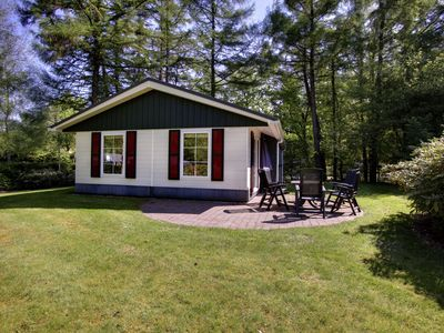 Photo for Comfortable detached chalet with dishwasher, located on the water or in the forest in holiday park