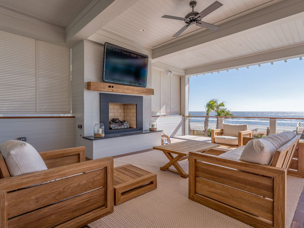 Outdoor Seating Surrounding Mounted Television