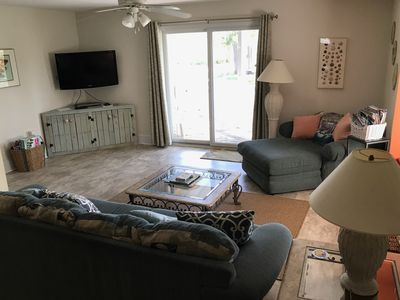 Photo for Gulf View! . 2 BD/2.5 BA steps from beach- new flooring