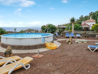 Photo for Typical Canarian house with spacious outdoor area, shared pool, parking space and wifi