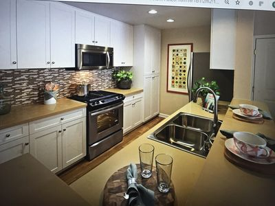 Photo for 3 Bedroom, 2 bathroom town home on a marina with salt water pool, spa, and gym