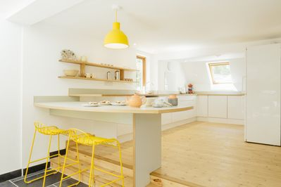Light and airy kitchen with breakfast bar.  Very well equipped for dining.