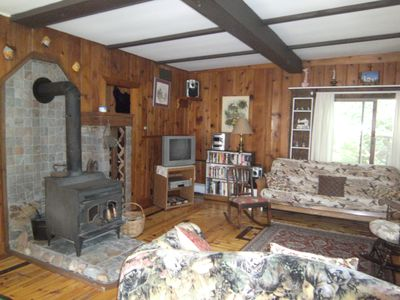 roomy living room space with wood burning stove