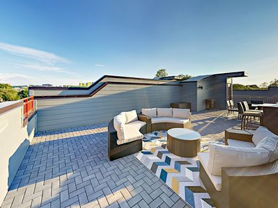 Rooftop Deck - The deck was made for entertaining! Circle lounge seating offers room for all your friends.