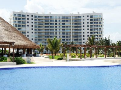 HOME OFFICE?....ENJOY  IT AT CANCUN AT AN AFFORDABLE  NICE  BEACHFRONT CONDO,
