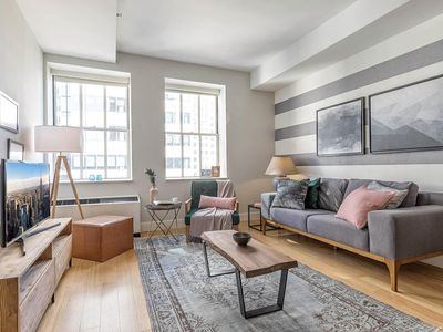 Photo for Comfy Wall Street 1BR w/ Speakeasy, Gym, + Rooftop by Blueground