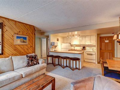 Photo for Ski-in/ski-out condo, Fully stocked kitchen, Indoor/outdoor hot tubs, Garage parking!