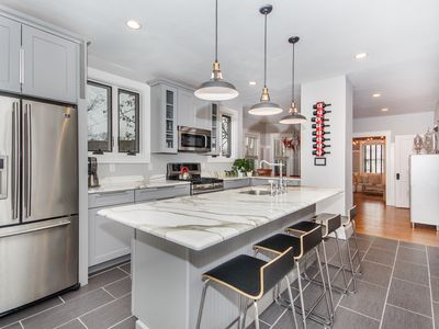Impeccably Renovated 3 Story Home w/ 4 Bedrooms in Vibrant Hip Neighborhood