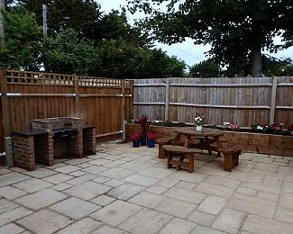 Garden with Bicycle store, bench seating and BBQ