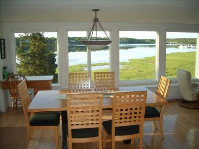 DINING AREA.   TABLE CAN BE EXPANDED TO EASILY SEAT 8