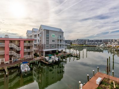 Photo for NEW LISTING! Amazing waterfront condo with fireplace, shared pool, and free WiFi