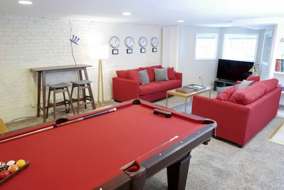 Industrial design and red hues contribute to the cool space