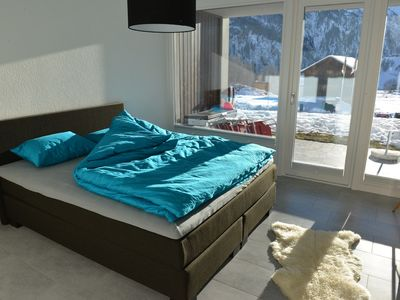 Photo for Stylish apartment with sun terrace right on the slopes in the mountains
