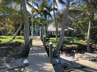 Photo for GATED PRIVATE ESTATE W/ APPROXIMATELY ACRE OF PALM TREES  KEY WEST STYLE