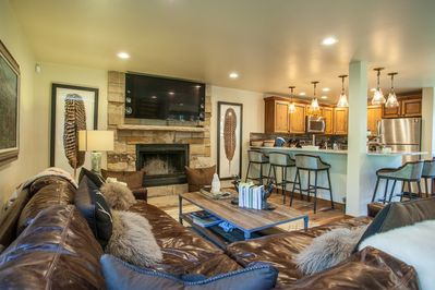 Modern mountain style with the living room, dining and kitchen as one lovely space to gather with friends and family.
