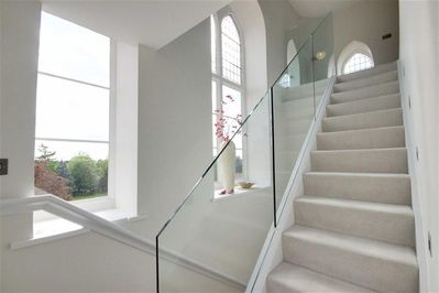 Staircase with large gothic windows