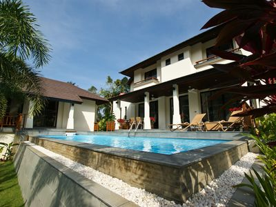 Photo for luxury villa with an own pool and in view of the Santiburi golf course