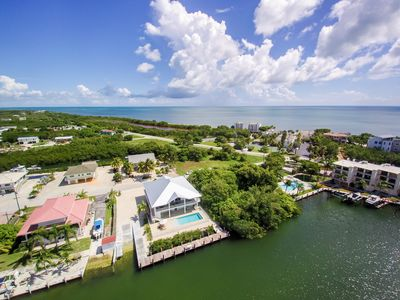 Photo for Gorgeous and new luxury waterfront home w/ Pool, Extra Long Dock and Boat Ramp