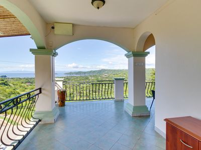Photo for Convenient suite with shared pool and balcony w/ ocean views