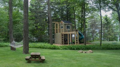 The tranquil backyard with custom play set.