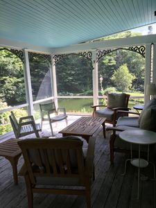 Large screened porch overlooking swimming pond