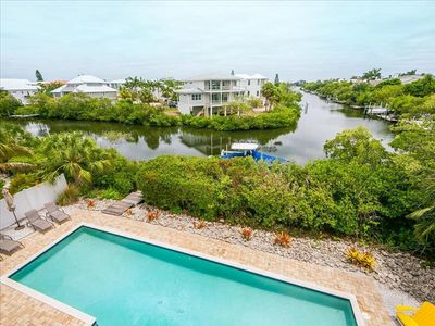 Photo for Mangroves and Magnolias- Tropical island home on North end.