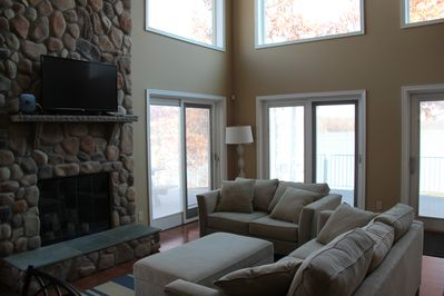 Family room with TV above fire place