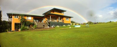 our front yard, on the island of rainbows, guest suite is on left, over river