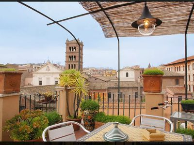 Photo for A Beautiful Attic with Terrace in the Heart of Trastevere (WiFi Free)