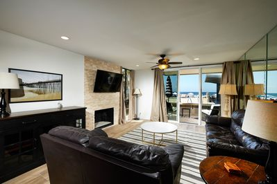 Relax in your ocean view living area with cozy stone fireplace!