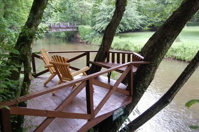 Relax on the deck over the river!