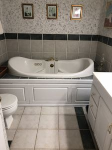 Large jetted tub in main bathroom.
