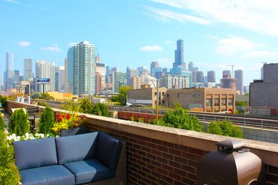 4th Floor Private Terrace with Skyline Views! Flowers and Seating for 6.