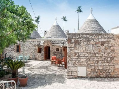 Photo for Trulli in the countryside with private pool between the fruit and olive trees