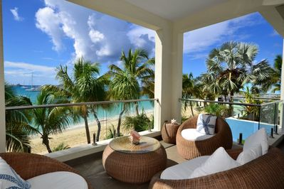 Private covered terrace with sand and sea views