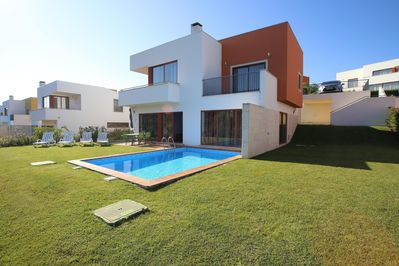 View of the Villa with private pool and private gardens with 2 Parking Spaces