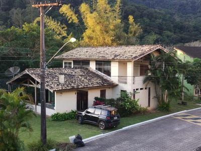 Photo for Beautiful family home with large green area on the elegant beach of Paúba