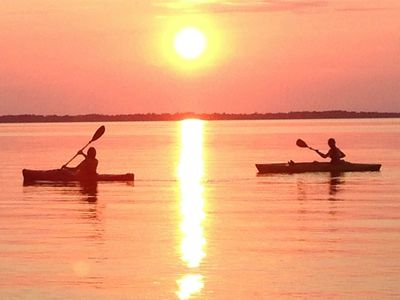 Kayaking at sunset in front of the cottage