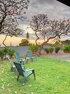 Enjoy sunsets on your private lawn with ocean views, surrounded by plumeria