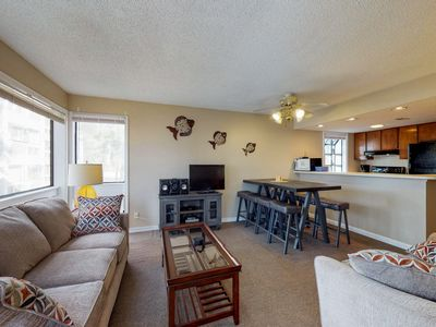 Photo for Condo ideal for families with shared pools and hot tub only steps from the beach