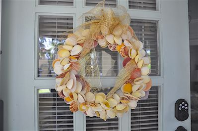 Shell wreath on front door to welcome you.