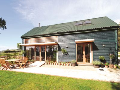 Photo for 5* Converted Barn in an area of 'Outstanding Natural Beauty'. Sleeps 6 + baby