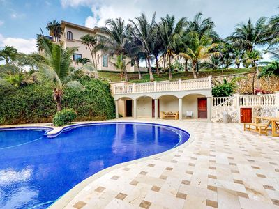 Photo for Bright villa w/ private deck, shared tropical pool & easy West Bay Beach access!