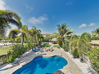 Photo for Immaculate Canal Home w/ Private Pool, Dock & Game Lounge - By the Beach