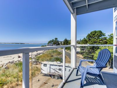 Photo for Waterfront corner condo with ocean views - close to beach, bay, & attractions