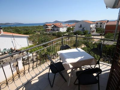 Photo for Two bedroom apartment with terrace and sea view Tribunj (Vodice) (A-6223-b)